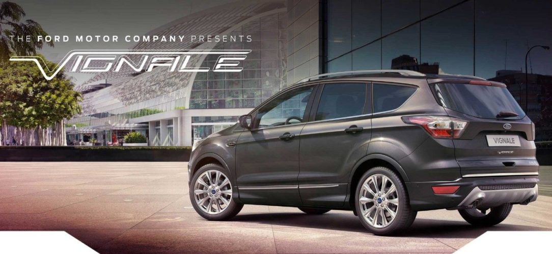 ford-kuga_vignale-eu-3_VIGK_M_L_37300-21x9-2160x925-bb-grey-kuga-parked-by-glass-building.jpg.renditions.extra-large